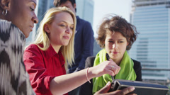 Cheerful group of businesswomen in a meeting outdoors in the city on a sunny day - stock footage