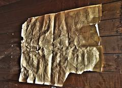wrinkled and creased old map - stock photo