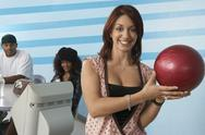 Woman Holding A Bowling Ball Stock Photos