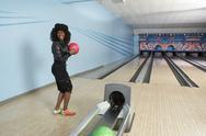 Young Woman At Bowling Ball Stock Photos