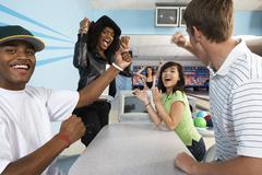 Stock Photo of Friends Cheering At Bowling Alley