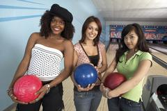 Stock Photo of Female Friends With Balls In Bowling Alley