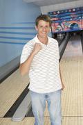Man Cheering At Bowling Alley - stock photo