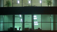 Stock Video Footage of Office windows night shift, business center floor, rooms light
