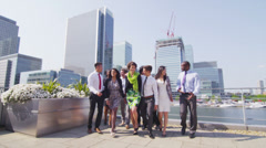 Portrait of a cheerful mixed ethnicity business team outdoors in the city - stock footage