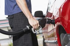 Man Refueling His Car - stock photo