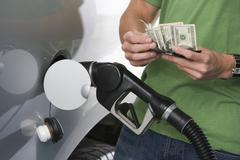 Man Counting Money While Refueling Car Stock Photos