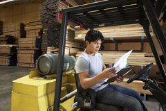 Worker Reading Documents Stock Photos