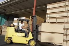 Manual Worker Operating Forklift Truck In Lumber Industry Stock Photos