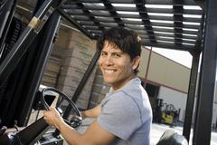 Portrait Of A Male Worker Driving Forktruck - stock photo