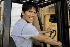 Portrait Of A Worker Driving Forktruck - stock photo
