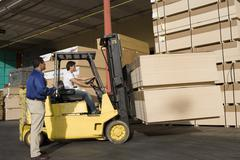 Warehouseman And Forklift Truck Driver In Timber Factory Stock Photos