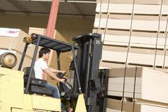 Laborer With Forklift Stacking Wood Stock Photos