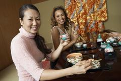 Women Having Japanese Saki In Restaurant - stock photo