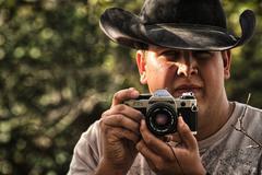 Cowboy Cameraman - stock photo