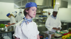 Portrait of a happy young worker in a commercial kitchen - stock footage