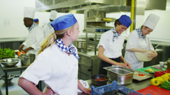 Portrait of a happy young worker in a commercial kitchen Stock Footage