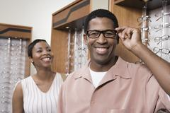 Stock Photo of An African American Man Trying On Glasses