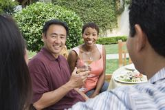 Couple And Friends Celebrating With Wine - stock photo