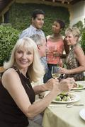 Woman Eating Lunch With Friends Stock Photos