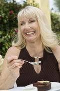 Stock Photo of Happy Woman Having Sweet Dish