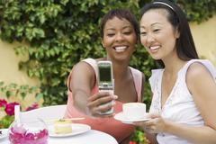 Women Taking Self-Portrait At Dinning Table - stock photo
