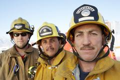 Portrait Of Three Fire Fighters Stock Photos