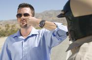 Traffic Cop Taking Sobriety Test Stock Photos