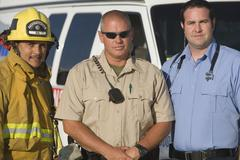 Portrait Of Firefighter, Traffic Cop And EMT Doctor - stock photo