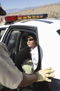 Arrested Woman Sitting In Police Car - stock photo