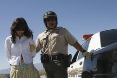Cop Arresting Female Driver - stock photo