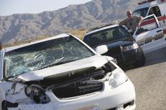 Police Officer At Scene Of Car Crash Stock Photos