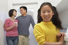Teenager Smiling With Parents In Background Stock Photos