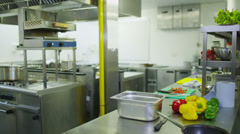 Mature female chef working alone in a commercial kitchen Stock Footage