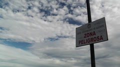 Zona Peligrosa Sign clouds timelapse Stock Footage