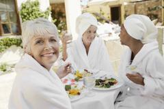 Senior Woman Having Healthy Food With Friends - stock photo