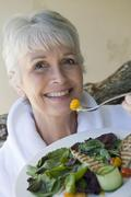 Woman Eating Healthy Food Stock Photos