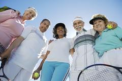 Stock Photo of Senior Tennis Players Smiling