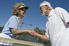 Active Senior Tennis Players Shaking Hands Stock Photos