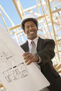 Civil Engineer Holding Blueprint Stock Photos