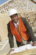 Surveyor With Blueprints At Construction Site Stock Photos