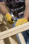 Worker Hammering A Nail At Site Stock Photos