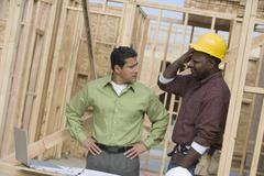 Stock Photo of Engineer And Foreman In Discussion At Site