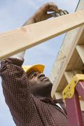 Stock Photo of Worker Working At Construction Site