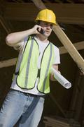 Manual Worker Using Cell Phone At Site Stock Photos