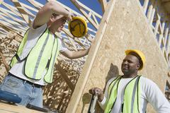 Workers Taking Break At Site - stock photo