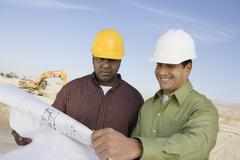 Construction Workers Reading Blueprints Stock Photos