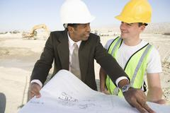 Stock Photo of Architect And Worker In Discussion At Site