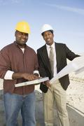 Architect And Foreman At Construction Site - stock photo