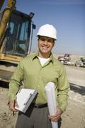 Foreman With Clipboard And Blueprint At Site - stock photo